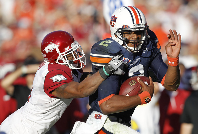 AUBURN - OCTOBER 16:  Quarterback Cam Newton #2 of the Auburn Tigers (right) is tackled by safety Tramain Thomas #5 of the Arkansas Razorbacks during the game at Jordan-Hare Stadium on October 16, 2010 in Auburn, Alabama.  (Photo by Mike Zarrilli/Getty Im