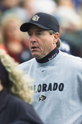 BOULDER, CO - NOVEMBER 23:  Head coach Gary Barnett of the Colorado Buffaloes jogs on the field during the Big 12 Conference football game against the Nebraska Cornhuskers on November 23, 2001 at Folsom Field in Boulder, Colorado.  The Buffaloes crushed t
