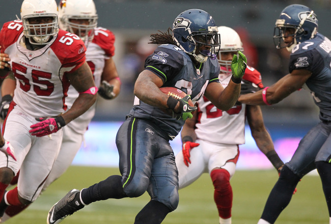 SEATTLE - OCTOBER 24:  Running back Marshawn Lynch #24 of the Seattle Seahawks rushes against Joey Porter #55 of the Arizona Cardinals at Qwest Field on October 24, 2010 in Seattle, Washington. (Photo by Otto Greule Jr/Getty Images)