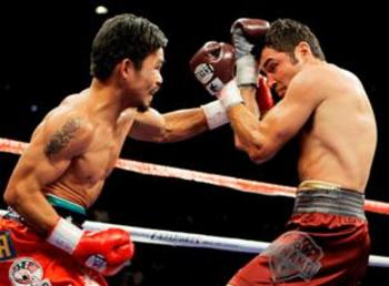 A weight drained Oscar De La Hoya is destroyed by the smaller Pacman