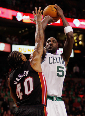BOSTON, MA - OCTOBER 26: Kevin Garnett #5 of the Boston Celtics shots against the defense of Udonis Haslem #40 of the Miami Heat at the TD Banknorth Garden on October 26, 2010 in Boston, Massachusetts. NOTE TO USER: User expressly acknowledges and agrees