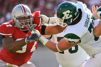COLUMBUS, OH - SEPTEMBER 25:  Cameron Heyward #97 of the Ohio State Buckeyes fights through a block by Andrew Sorgatz #72 of the Eastern Michigan Eagles at Ohio Stadium on September 25, 2010 in Columbus, Ohio.  Ohio State won 73-20. (Photo by Jamie Sabau/