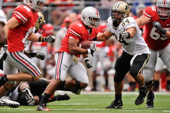 COLUMBUS, OH - OCTOBER 23:  Ryan Kerrigan #94 of the Purdue Boilermakers attempts to tackle Brandon Saine #3 of the Ohio State Buckeyes at Ohio Stadium on October 23, 2010 in Columbus, Ohio.  (Photo by Jamie Sabau/Getty Images)