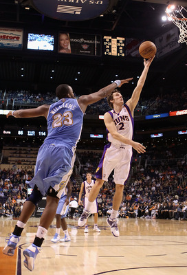PHOENIX - OCTOBER 22:  Goran Dragic #2 of the Phoenix Suns lays up a shot past Shelden Williams #23 of the Denver Nuggets during the preseason NBA game at US Airways Center on October 22, 2010 in Phoenix, Arizona. NOTE TO USER: User expressly acknowledges