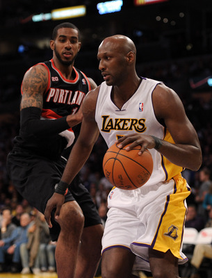 LOS ANGELES, CA - NOVEMBER 07:  Lamar Odum #7 of the Los Angeles Lakers dribbles around LaMarcus Aldridge #12 of the Portland Trail Blazers at the Staples Center on November 7, 2010 in Los Angeles, California.  NOTE TO USER: User expressly acknowledges an