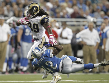 DETROIT - OCTOBER 10:  Steven Jackson #39 of the St. Louis Rams runs through the tackle of Amari Spievey #42 of the Detroit Lions on October 10, 2010 at Ford Field in Detroit, Michigan.  (Photo by Gregory Shamus/Getty Images)