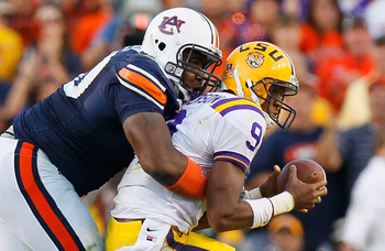AUBURN, AL - OCTOBER 23:  Nick Fairley #90 of the Auburn Tigers sacks quarterback Jordan Jefferson #9 of the LSU Tigers at Jordan-Hare Stadium on October 23, 2010 in Auburn, Alabama.  (Photo by Kevin C. Cox/Getty Images)