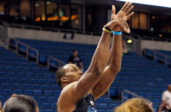 TAMPA, FL - OCTOBER 22:  Center Dwight Howard #12 of the Orlando Magic warms up prior to game against the Miami Heat at the St. Pete Times Forum on October 22, 2010 in Tampa, Florida. The game was cancelled due to a slippery floor.  NOTE TO USER: User exp