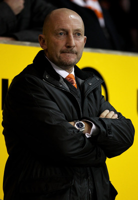BLACKPOOL, ENGLAND - NOVEMBER 01:   Blackpool Manager Ian Holloway looks on during the Barclays Premier League match between Blackpool and West Bromwich Albion at Bloomfield Road on November 1, 2010 in Blackpool, England. (Photo by Alex Livesey/Getty Imag