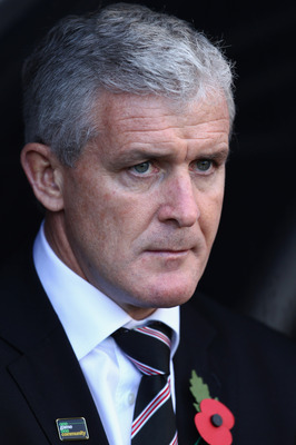 LONDON, ENGLAND - OCTOBER 30:  Mark Hughes manager of Fulham looks on during the Barclays Premier League match between Fulham and Wigan Athletic at Craven Cottage on October 30, 2010 in London, England.  (Photo by Julian Finney/Getty Images)