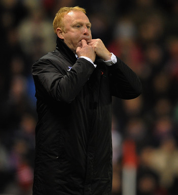 STOKE ON TRENT, ENGLAND - NOVEMBER 09:  Birmingham manager Alex McLeish whistles during the Barclays Premier League match between Stoke City and Birmingham City at the Britannia Stadium on November 9, 2010 in Stoke on Trent, England.  (Photo by Michael Re