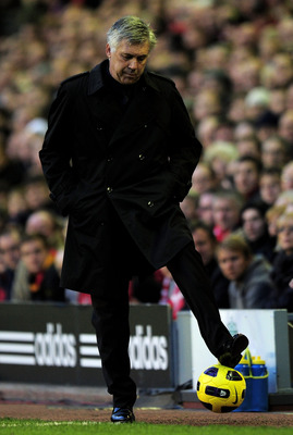LIVERPOOL, ENGLAND - NOVEMBER 07:   Chelsea Manager Carlo Ancelotti controls the ball during the Barclays Premier League match between Liverpool and Chelsea at Anfield on November 7, 2010 in Liverpool, England. (Photo by Shaun Botterill/Getty Images)