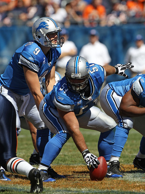 CHICAGO - SEPTEMBER 12: Dominic Raiola #51 of the Detroit Lions prepares to snap the ball to Matthew Stafford #9 during the NFL season opening game against the Chicago Bears at Soldier Field on September 12, 2010 in Chicago, Illinois. The Bears defeated t