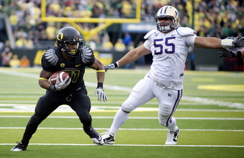 EUGENE, OR - NOVEMBER 6: Running back LaMichael James #21 of the Oregon Ducks runs with the ball as defensive tackle Sione Potoa'e #55 of the Washington Huskies closes in during the third quarter of the game at Autzen Stadium on November 6, 2010 in Eugene