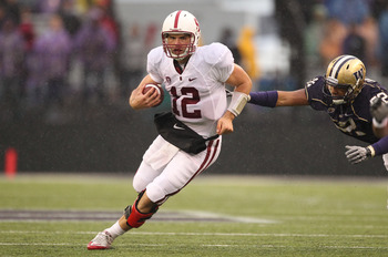 SEATTLE - OCTOBER 30:  Quarterback Andrew Luck #12 of the Stanford Cardinal rushes against Hau'oli Jamora #52 of the Washington Huskies on October 30, 2010 at Husky Stadium in Seattle, Washington. Stanford won 41-0. (Photo by Otto Greule Jr/Getty Images)