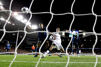 LONDON, ENGLAND - NOVEMBER 02:  Peter Crouch of Spurs gets infront of Walter Samuel of Inter Milan to prod the ball into the net, but the goal is disaallowed during the UEFA Champions League Group A match between Tottenham Hotspur and Inter Milan at White
