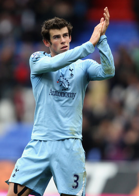 BOLTON, ENGLAND - NOVEMBER 06:  Gareth Bale of Tottenham Hotspur waves to the crowd after the Barclays Premier League match between Bolton Wanderers and Tottenham Hotspur at the Reebok Stadium on November 6, 2010 in Bolton, England.  (Photo by Clive Bruns