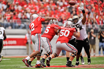 COLUMBUS, OH - OCTOBER 23:  Brandon Taylor #55 of the Purdue Boilermakers attempts to block a pass attempt by Terrelle Pryor #2 of the Ohio State Buckeyes at Ohio Stadium on October 23, 2010 in Columbus, Ohio.  (Photo by Jamie Sabau/Getty Images)