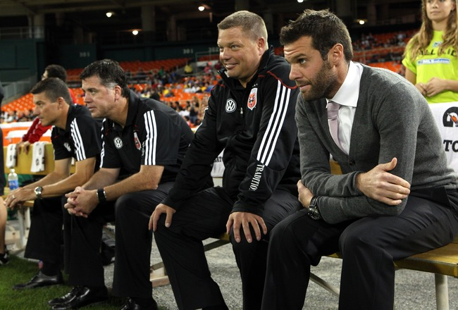 WASHINGTON - OCTOBER 09: Head coach Ben Olsen of D.C. Unitedsits on the bench against the San Jose Earthquakes at RFK Stadium on October 9, 2010 in Washington, DC. San Jose won 2-0. (Photo by Ned Dishman/Getty Images)