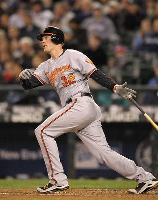 SEATTLE - APRIL 20:  Matt Wieters #32 of the Baltimore Orioles bats against the Seattle Mariners at Safeco Field on April 20, 2010 in Seattle, Washington. (Photo by Otto Greule Jr/Getty Images)
