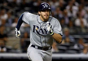 NEW YORK - SEPTEMBER 23:  Evan Longoria #3 of the Tampa Bay Rays hits a double in the sixth-inning against the New York Yankees  on September 23, 2010 at Yankee Stadium in the Bronx borough of New York City.  (Photo by Mike Stobe/Getty Images)