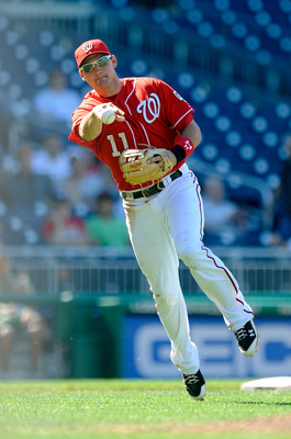 WASHINGTON - JULY 11:  Ryan Zimmerman #11 of the Washington Nationals throws the ball to first base against the San Francisco Giants at Nationals Park on July 11, 2010 in Washington, DC.  (Photo by Greg Fiume/Getty Images)