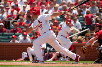 ST. LOUIS - JUNE 30: Matt Holliday #7 of the St. Louis Cardinals hits an RBI triple against the Arizona Diamondbacks at Busch Stadium on June 30, 2010 in St. Louis, Missouri.  (Photo by Dilip Vishwanat/Getty Images)