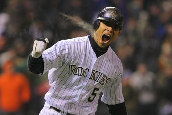 DENVER - OCTOBER 11:  Carlos Gonzalez #5 of the Colorado Rockies reacts after hitting a home run in the bottom of the fourth inning against the Philadelphia Phillies in Game Three of the NLDS during the 2009 MLB Playoffs at Coors Field on October 11, 2009