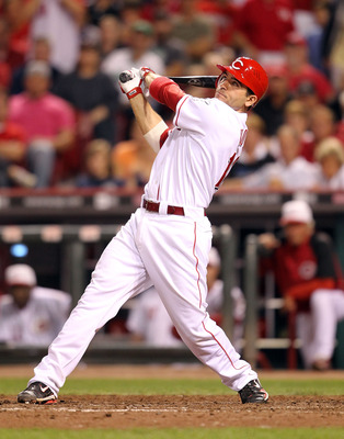 CINCINNATI - SEPTEMBER 11:  Joey Votto #19 of the Cincinnati Reds hits a game winning home run during the game against the Pittsburg Pirates at Great American Ball Park on September 11, 2010 in Cincinnati, Ohio. The Reds won 5-4  (Photo by Andy Lyons/Gett