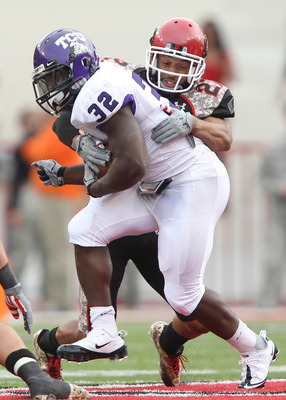 SALT LAKE CITY, UT - NOVEMBER 6: Waymon James #32 of the TCU Horned Frogs is hit by Brandon Burton #27 the Utah Utes during the second half of an NCAA Football game November 6, 2010 at Rice-Eccles Stadium in Salt Lake City, Utah. TCU Beat Utah 47-7.  (Pho