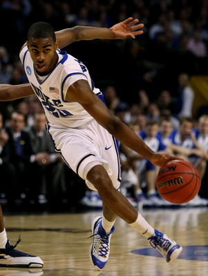 BOSTON - MARCH 26:  Elliot Williams #20 of the Duke Blue Devils dribbles against the Villanova Wildcats during the NCAA Men's Basketball Tournament East Regionals at TD Banknorth Garden on March 26, 2009 in Boston, Massachusetts.  (Photo by Elsa/Getty Ima
