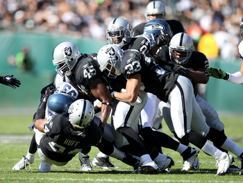 OAKLAND, CA - OCTOBER 31:  The Oakland Raiders defense tackles Leon Washington #33 of the Seattle Seahawks at Oakland-Alameda County Coliseum on October 31, 2010 in Oakland, California.  (Photo by Ezra Shaw/Getty Images)