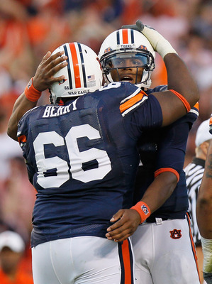 AUBURN, AL - OCTOBER 23:  Quarterback Cameron Newton #2 and Mike Berry #66 of the Auburn Tigers against the LSU Tigers at Jordan-Hare Stadium on October 23, 2010 in Auburn, Alabama.  (Photo by Kevin C. Cox/Getty Images)