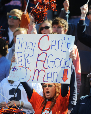 AUBURN, AL - NOVEMBER 06:  Fans of the Auburn Tigers cheer play against the Chattanooga Mocs November 6, 2010 at Jordan-Hare Stadium in Auburn, Alabama.  (Photo by Al Messerschmidt/Getty Images)