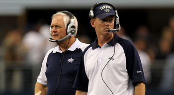 ARLINGTON, TX - OCTOBER 31:  (L-R) Head coach Wade Phillips and assistant head coach/offensive coordinator Jason Garrett of the Dallas Cowboys look on against the Jacksonville Jaguars at Cowboys Stadium on October 31, 2010 in Arlington, Texas.  (Photo by