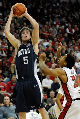 LAS VEGAS - NOVEMBER 18:  Luke Babbitt #5 of the Nevada Wolf Pack shoots over Steve Jones #20 of the UNLV Rebels during their game at the Thomas &amp; Mack Center on November 18, 2009 in Las Vegas, Nevada. UNLV won 88-75.  (Photo by Ethan Miller/Getty Images)