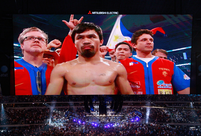 ARLINGTON, TX - MARCH 13:  Manny Pacquiao of the Philippines in the ring before taking on Joshua Clottey of Ghana during the WBO welterweight title fight at Cowboys Stadium on March 13, 2010 in Arlington, Texas.  (Photo by Tom Pennington/Getty Images)