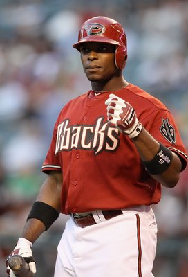 PHOENIX - MAY 19:  Justin Upton #10 of the Arizona Diamondbacks bats against the San Francisco Giants during the Major League Baseball game at Chase Field on May 19, 2010 in Phoenix, Arizona.  The Diamondbacks defeated the Giants 13-1.  (Photo by Christia