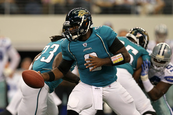 ARLINGTON, TX - OCTOBER 31:  Quaterback David Garrard #9 of the Jacksonville Jaguars turns to hand the ball off against the Dallas Cowboys at Cowboys Stadium on October 31, 2010 in Arlington, Texas.  (Photo by Stephen Dunn/Getty Images)