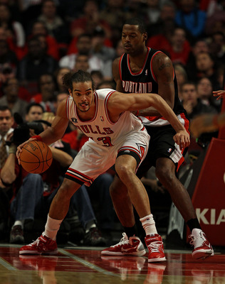 CHICAGO - NOVEMBER 01: Joakim Noah #13 of the Chicago Bulls moves against Marcus Camby #23 of the Portland Trail Blazers at the United Center on November 1, 2010 in Chicago, Illinois. The Bulls defeated the Trail Blazers 110-98. NOTE TO USER: User express