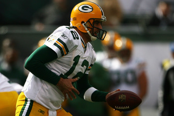 EAST RUTHERFORD, NJ - OCTOBER 31: Aaron Rodgers #12 of the Green Bay Packers hands off the ball during a game against the New York Jets on October 31, 2010 at the New Meadowlands Stadium in East Rutherford, New Jersey.  (Photo by Andrew Burton/Getty Image