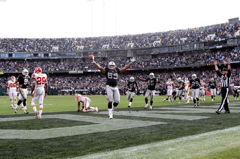 OAKLAND, CA - NOVEMBER 07: Khalif Barnes #69 of the Oakland Raiders celebrates after catching a touchdown against the Kansas City Chiefs during an NFL game at Oakland-Alameda County Coliseum on November 7, 2010 in Oakland, California.  (Photo by Jed Jacob