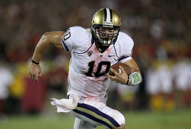 LOS ANGELES, CA - OCTOBER 02:  Quarterback Jake Locker #10 of the Washington Huskies carries the ball against the USC Trojans at the Los Angeles Memorial Coliseum on October 2, 2010 in Los Angeles, California.  Washington won 32-31.  (Photo by Stephen Dun