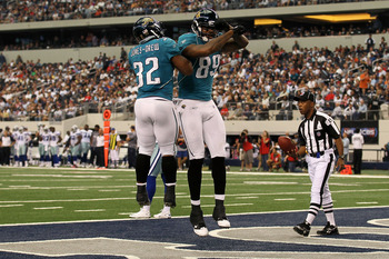 ARLINGTON, TX - OCTOBER 31:  (L-R) Maurice Jones-Drew #32 of the Jacksonville Jaguars #32 and Marcedes Lewis #89 of celebrate after Lewis scored a 42 yard touchdown reception in the first half against the Dallas Cowboys at Cowboys Stadium on October 31, 2