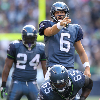 SEATTLE - NOVEMBER 07:  Quarterback Charlie Whitehurst #6 of the Seattle Seahawks gestures at the line of scrimmage against the New York Giants at Qwest Field on November 7, 2010 in Seattle, Washington. The Giants defeated the Seahawks 41-7. (Photo by Ott
