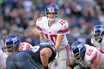 SEATTLE - NOVEMBER 07:  Quarterback Eli Manning #10 of the New York Giants looks over the defense at the line of scrimmage against the Seattle Seahawks at Qwest Field on November 7, 2010 in Seattle, Washington. The Giants defeated the Seahawks 41-7. (Phot