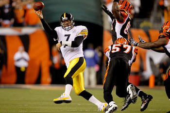 CINCINNATI - NOVEMBER 08:  Quarterback Ben Roethlisberger #7 of the Pittsburgh Steelers throws under pressure while playing the Cincinnati Bengals at Paul Brown Stadium on November 8, 2010 in Cincinnati, Ohio.  The Steelers defeated the Bengals 27-21. (Ph