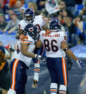 TORONTO, ON - NOVEMBER 07: Chris Williams #74, Chester Taylor #29 and Brandon Manumaleuna #86 of the Chicago Bears celebrate Taylor's touchdown in the third quarter against the Buffalo Bills  at Rogers Centre on November 7, 2010 in Toronto, Canada. Chicag