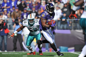 BALTIMORE, MD - NOVEMBER 7:  Willis McGahee #23 of the Baltimore Ravens runs the ball against the Miami Dolphins at M&T Bank Stadium on November 7, 2010 in Baltimore, Maryland. The Ravens defeated the Dolphins 26-10. (Photo by Larry French/Getty Images)