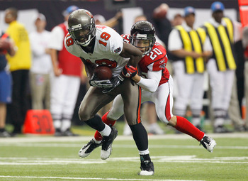 ATLANTA - NOVEMBER 07:  Mike Williams #19 of the Tampa Bay Buccaneers pulls in this reception against Brent Grimes #20 of the Atlanta Falcons at Georgia Dome on November 7, 2010 in Atlanta, Georgia.  (Photo by Kevin C. Cox/Getty Images)